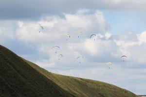 Paragliders around Rushup Edge