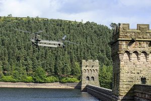 Chinook Helicopter Between Howden Dam Towers