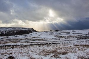 The Sun Breaking Through on Derwent Edge